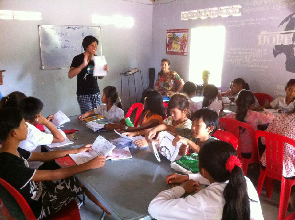 CIDTS Students Teaching in Cambodia from the Contextual Coloring Book